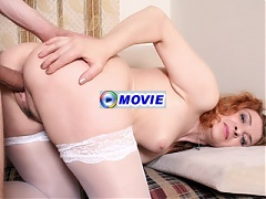 Mature redhead Ira Filimonova bares her clothes for a hardcore scene with a younger guy