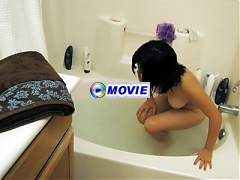 Asian mature ex girlfriend Chiyoko relaxes in the bathtub and strokes her snatch in this hot solo