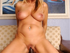Nicole Moore sits on top of a big black cock and uses her big MILF tits to milk it
