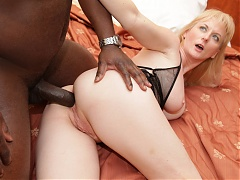 Cute mature with big breasts Monik exposes her big boobs and takes a black cock up her ass
