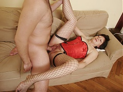 Eva is the stocking clad older woman spread legged on the couch for a live sex show